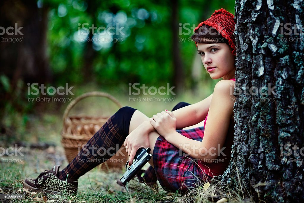 Little Red Riding Hood with a gun stock photo