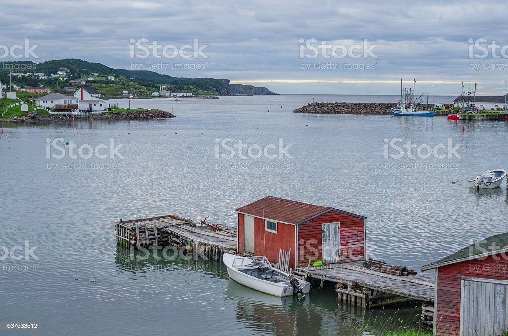 Little red shed & boat on a dock in Twillingate. stock photo