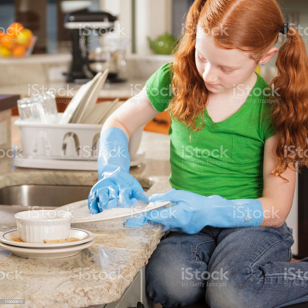 little red-haired girl washing dishes royalty-free stock photo