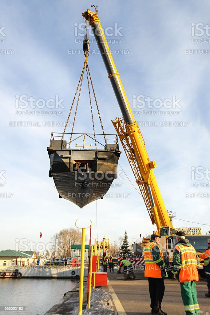 Little river ship carries a crane. stock photo