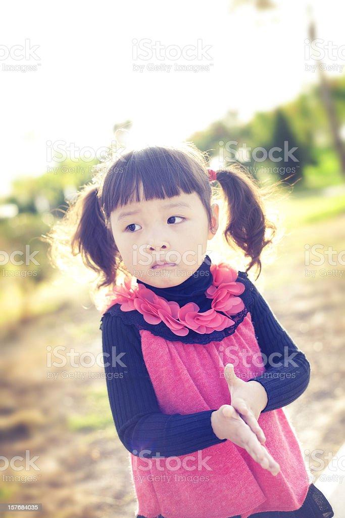 Little sad girl in park stock photo