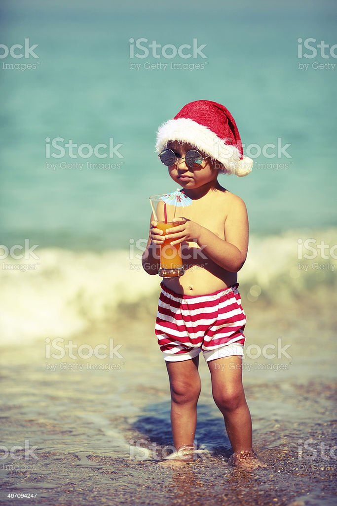 Little Santa Claus on the beach royalty-free stock photo