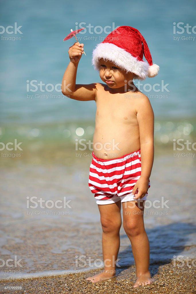 Little Santa Claus under an umbrella royalty-free stock photo