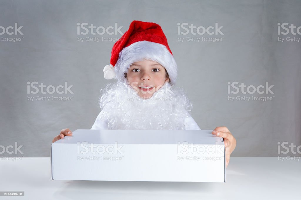 Little Santa holding white box and looking at the camera. stock photo