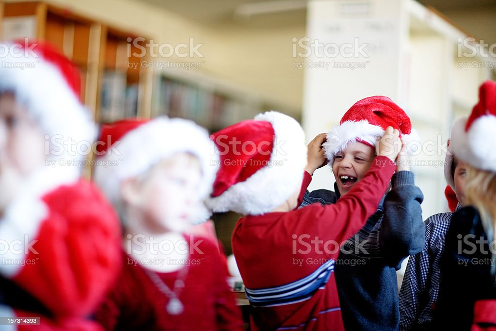 Little Santas get ready to put on a show stock photo
