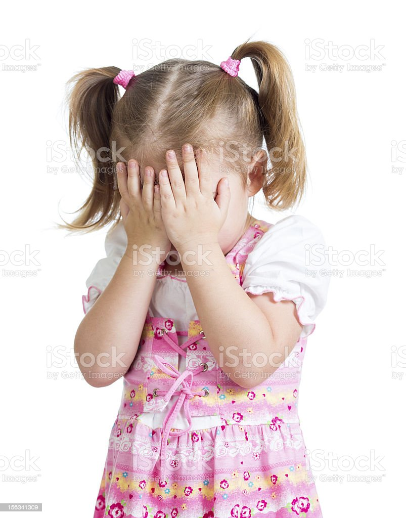 Little scared and crying or playing bo-peep girl hiding face royalty-free stock photo