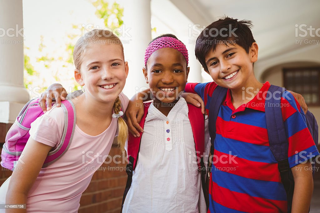 Little school kids in corridor stock photo