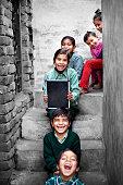 Little School Students portrait at home holding chalkboard