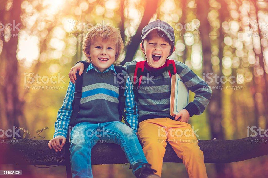 Little schoolboys in autumn stock photo