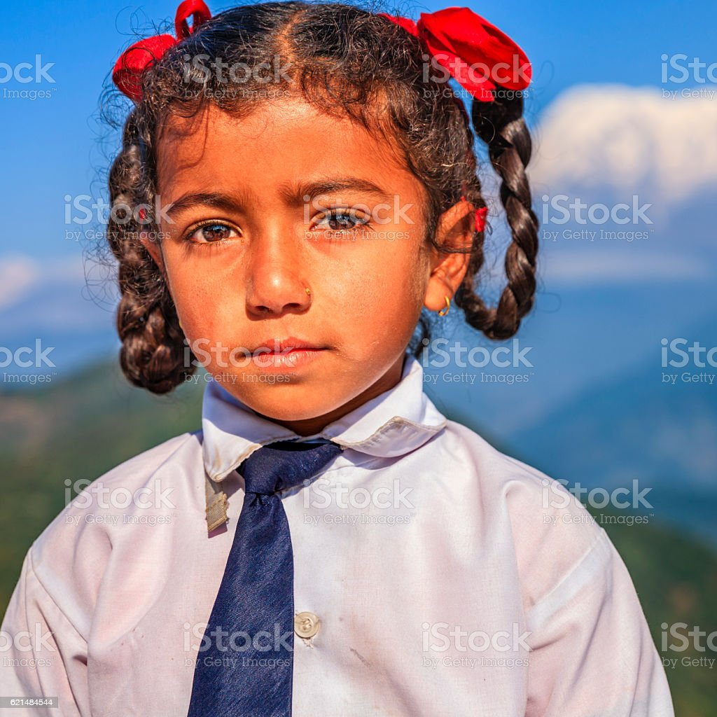 Little schoolgirl, Annapurna Range on background, Pokhara, Nepal stock photo
