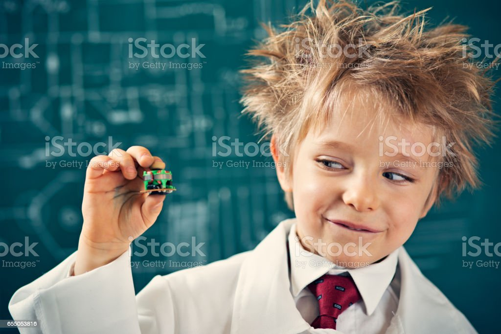 Little scientist holding a miniaturization invention stock photo