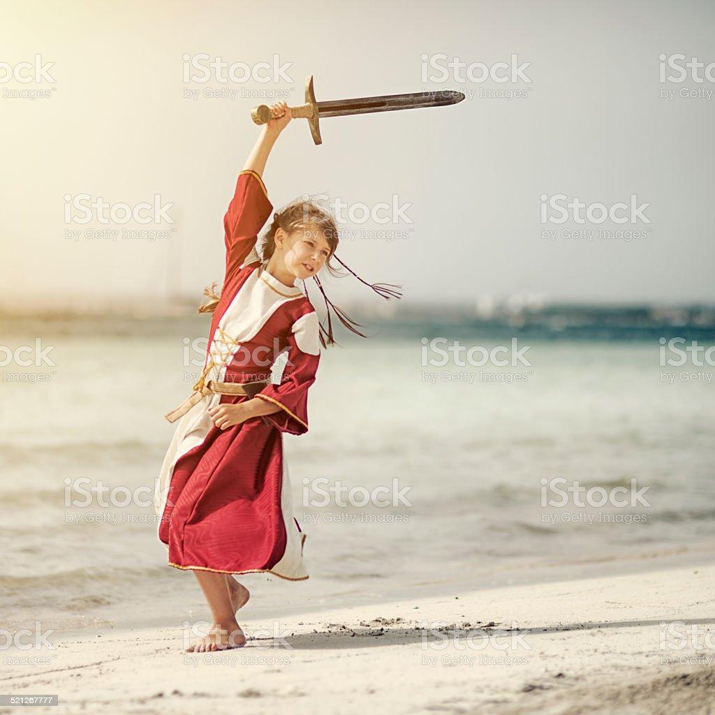 Little shieldmaiden practicing stock photo