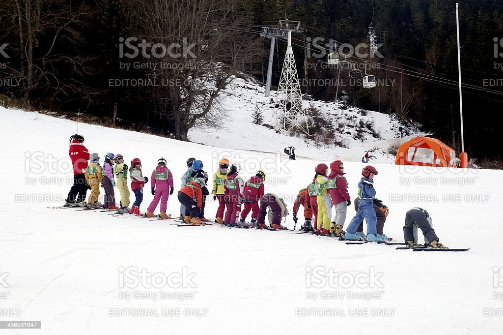 Little skier learners royalty-free stock photo