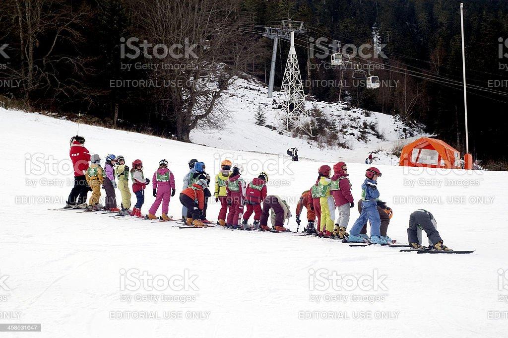 Little skier learners stock photo