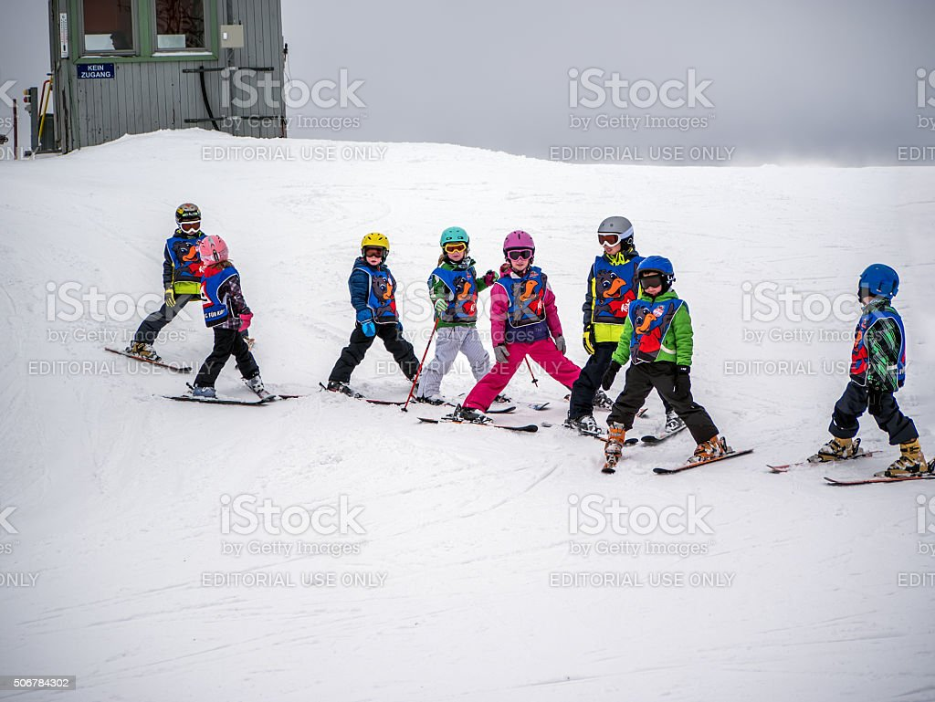 Little skiers are preparing for descent of the mount stock photo