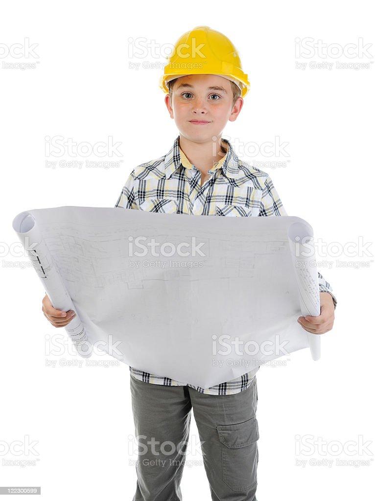 Little smiling builder in helmet royalty-free stock photo