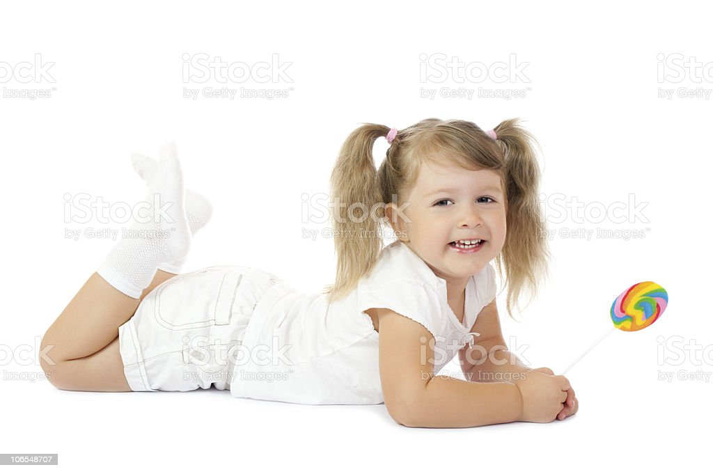 Little smiling girl with lollipop royalty-free stock photo