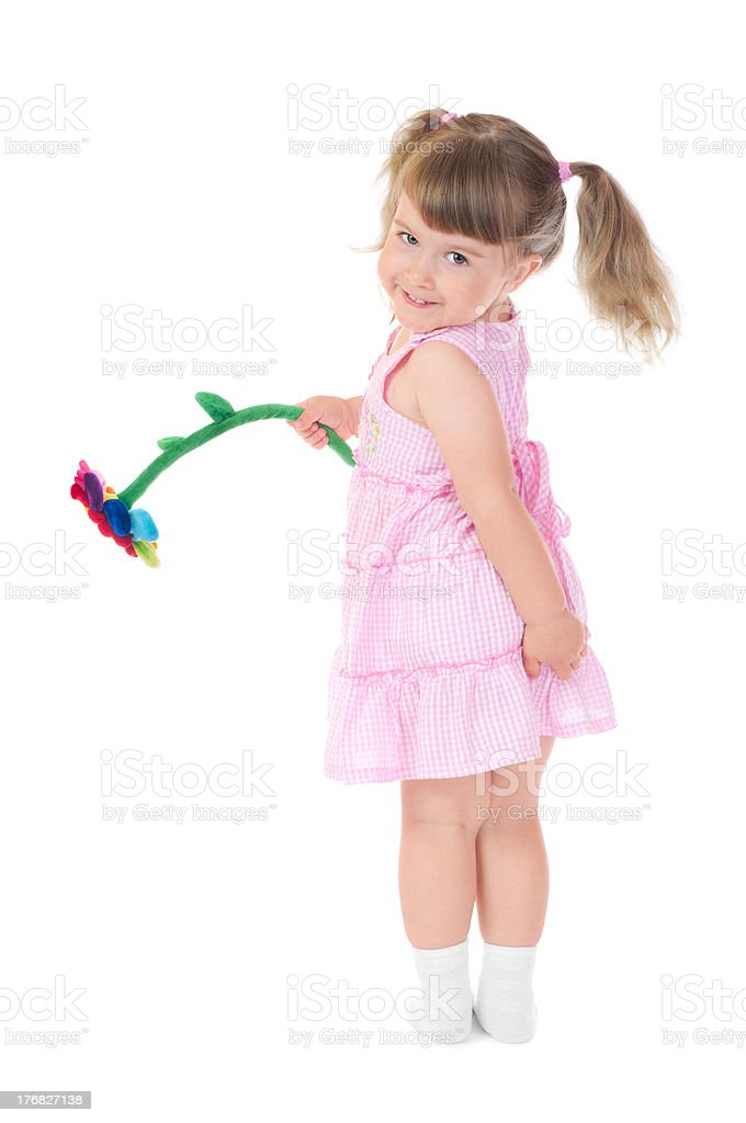 Little smiling girl with toy flower royalty-free stock photo