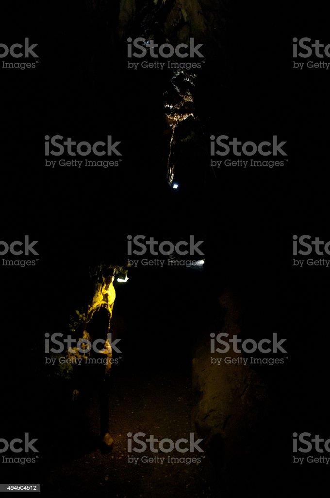 little spotlights in black cavern stock photo
