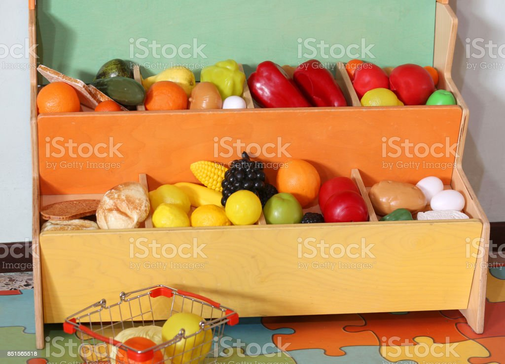 little stand of plastic fruits stock photo