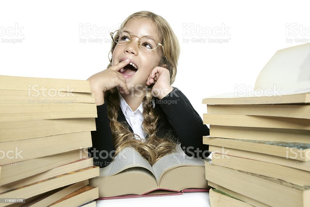 little student blond braided girl smiling stack books stock photo