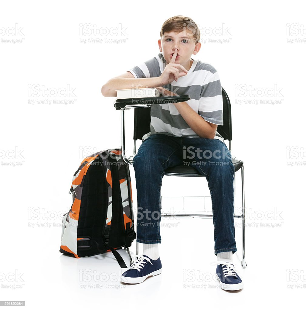 Little student doing the be quiet sign stock photo