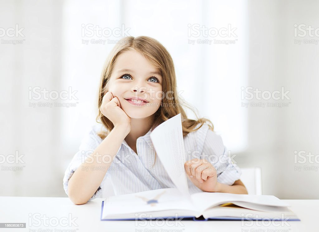 little student girl studying at school royalty-free stock photo