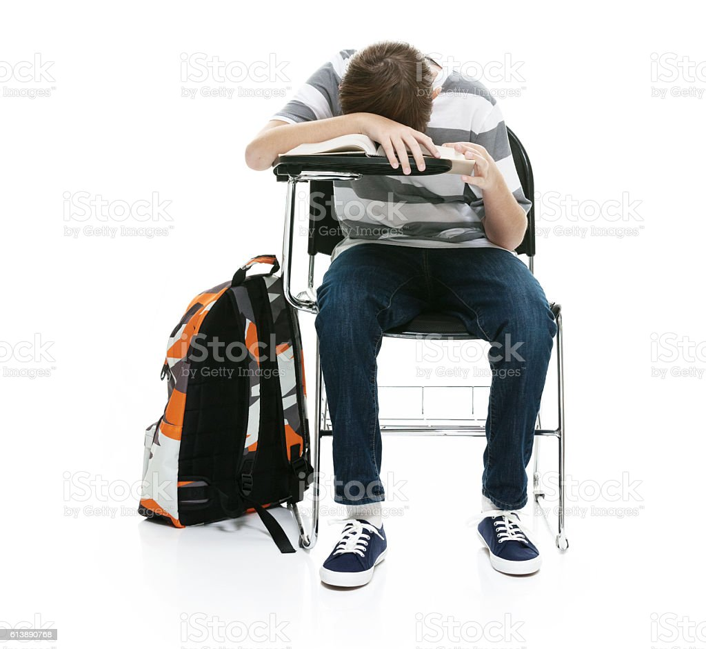 Little student looking tired and napping stock photo