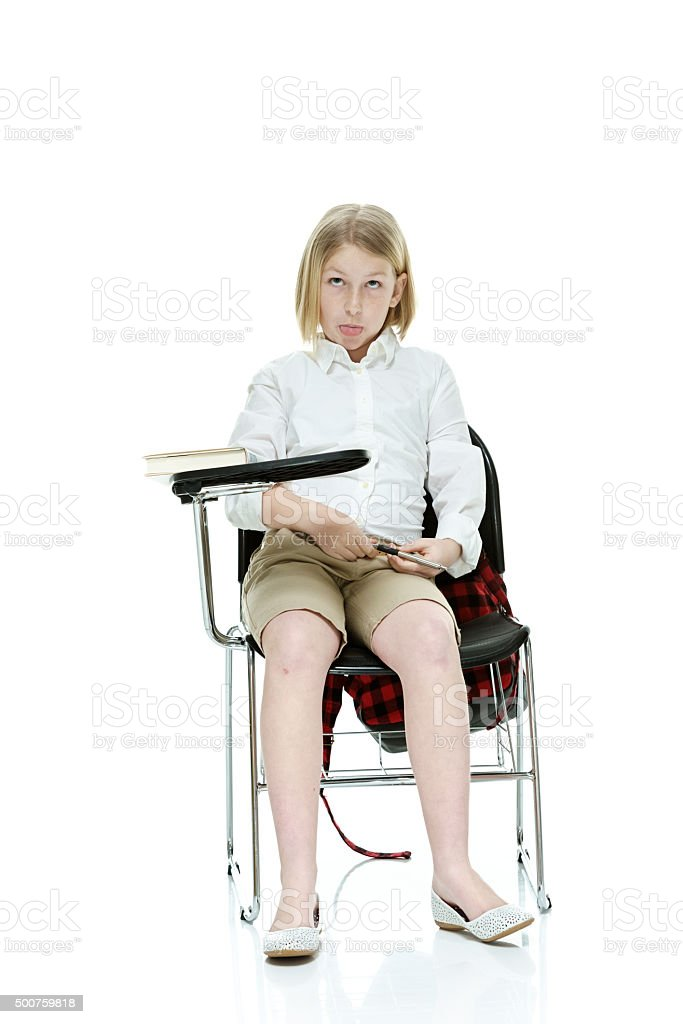 Little student on chair and being silly stock photo