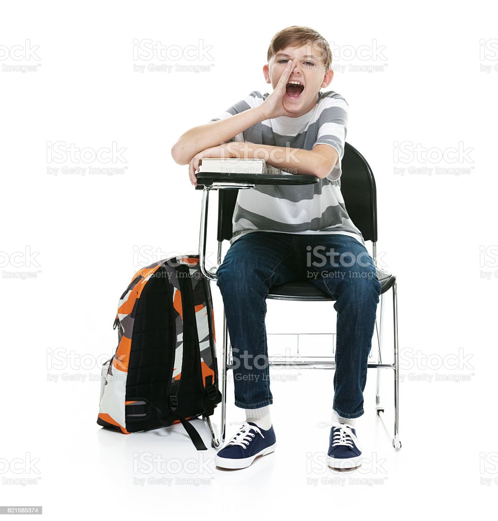 Little student sitting and shouting stock photo