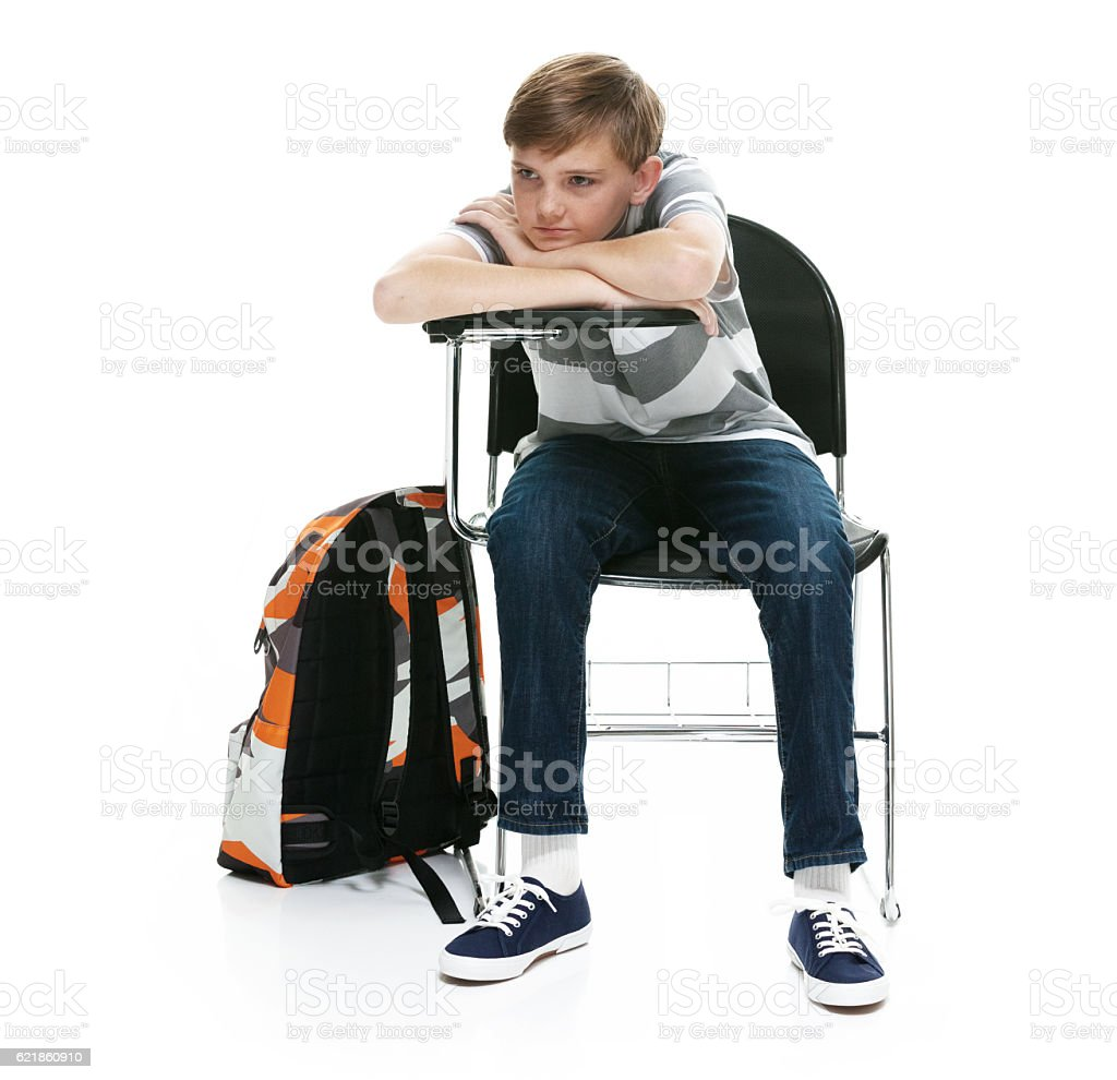 Little student sitting on chair stock photo