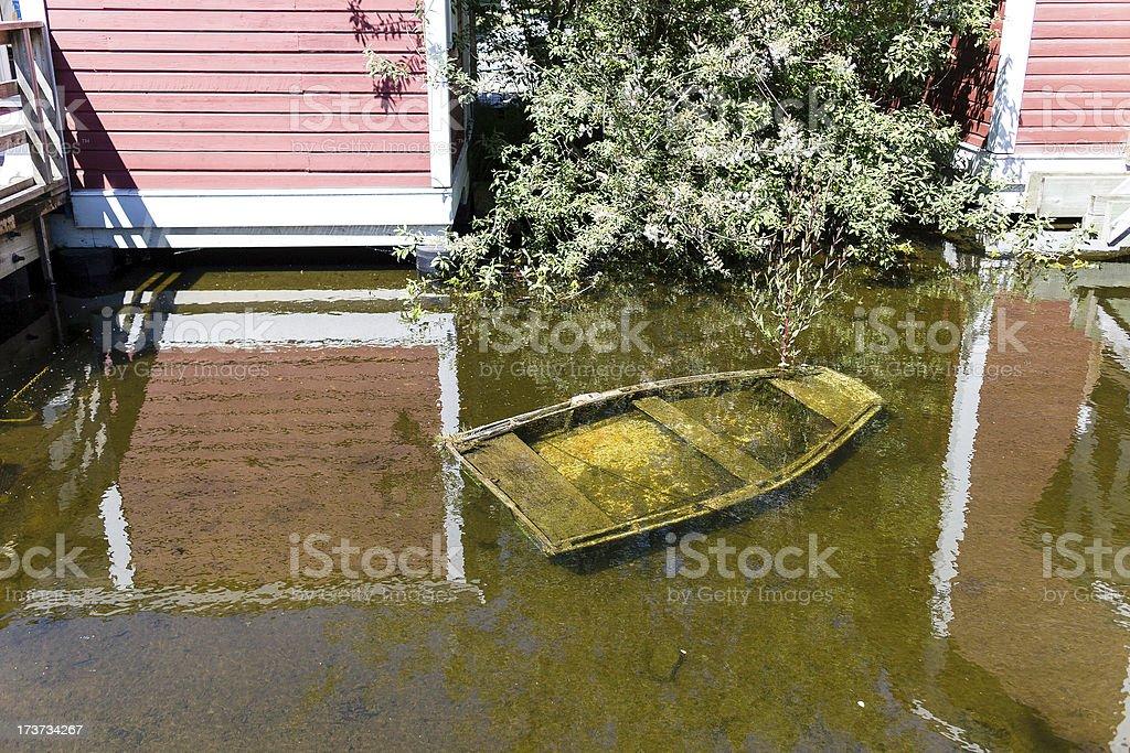 little submerged rowboat royalty-free stock photo