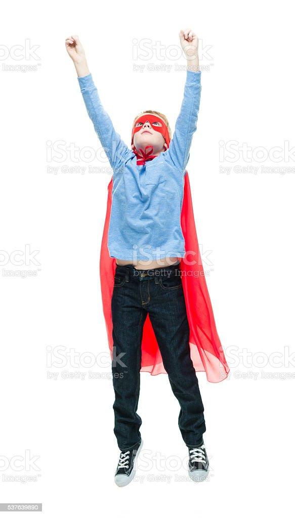 Little superhero flying stock photo