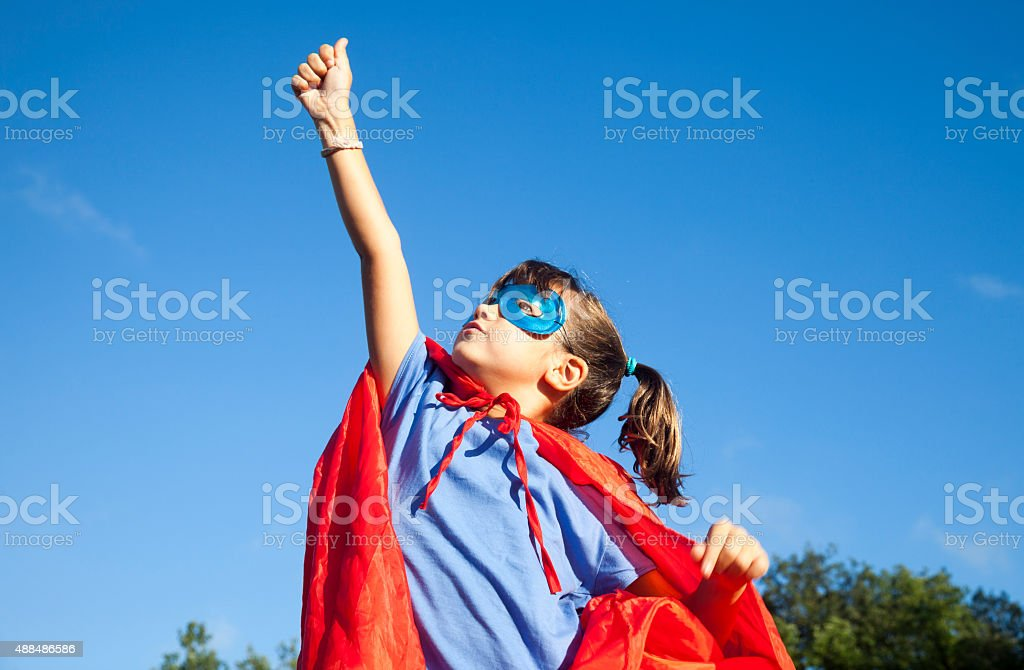 Little superhero girl stock photo