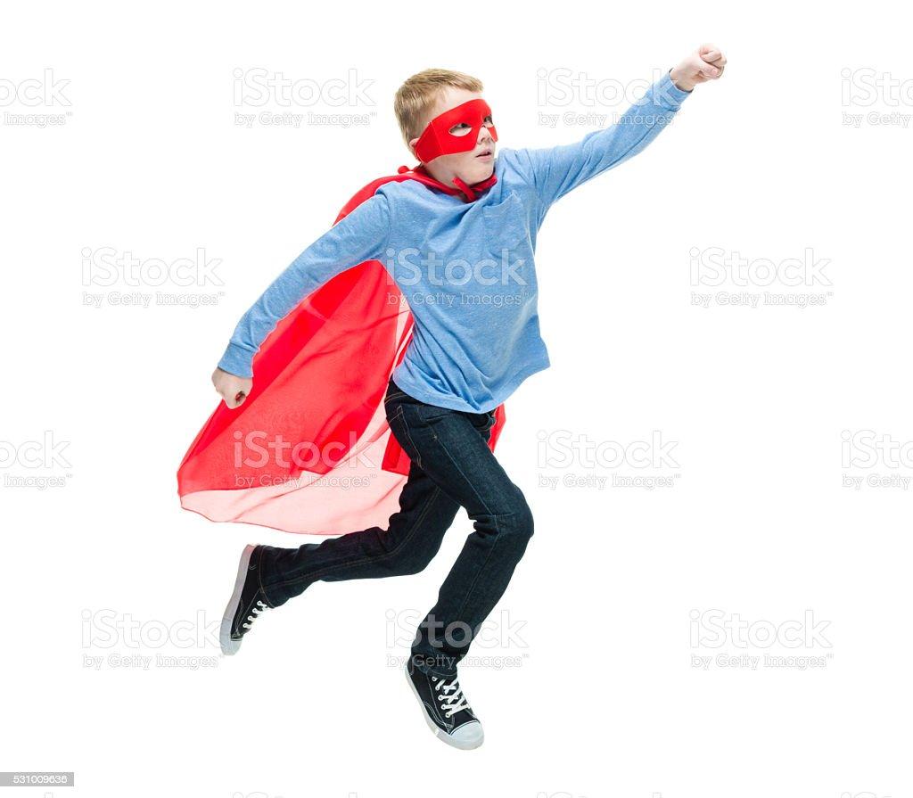 Little superhero jumping stock photo