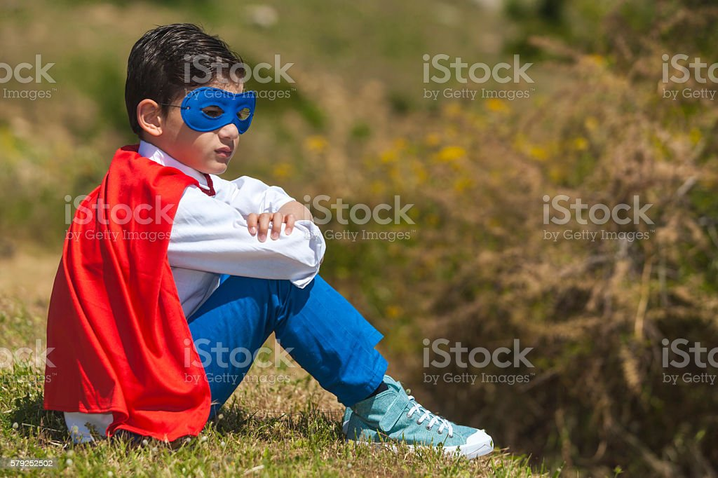 Little Superhero resting stock photo