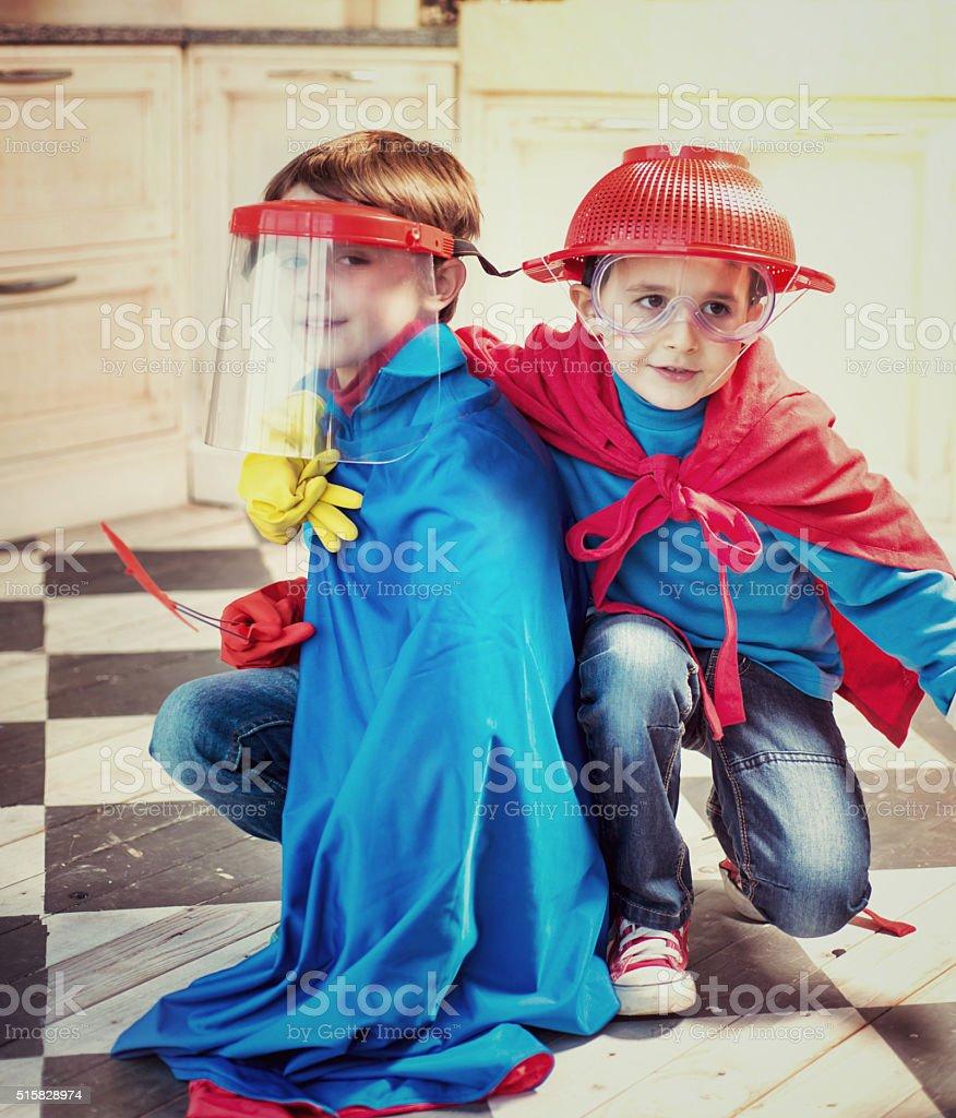 Little Superheros in Kitchen stock photo