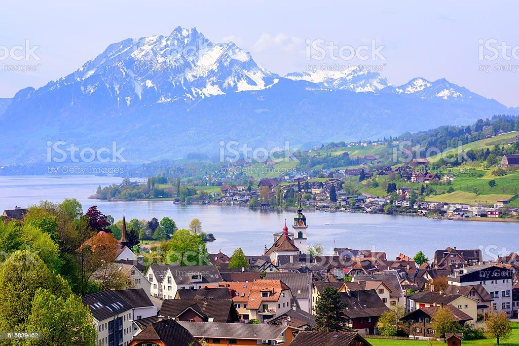 Little swiss town on Lake Lucerne and Pilatus mountain, Switzerland stock photo