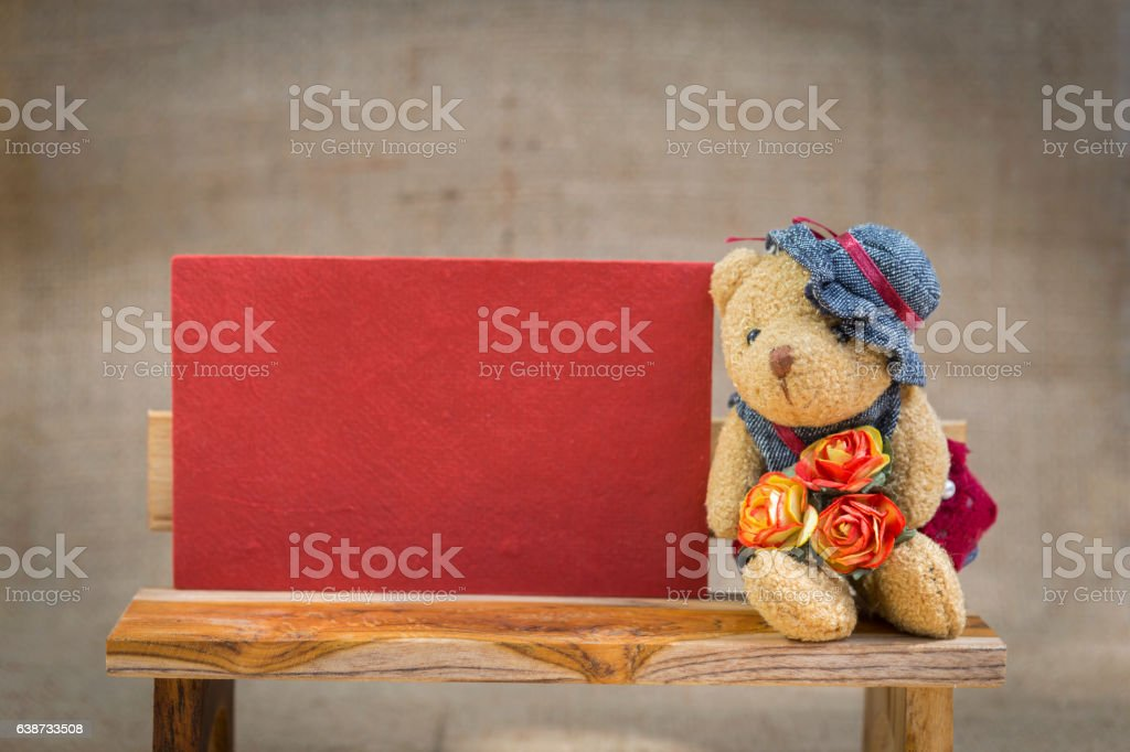 Little teddy bear with valentine red paper card stock photo