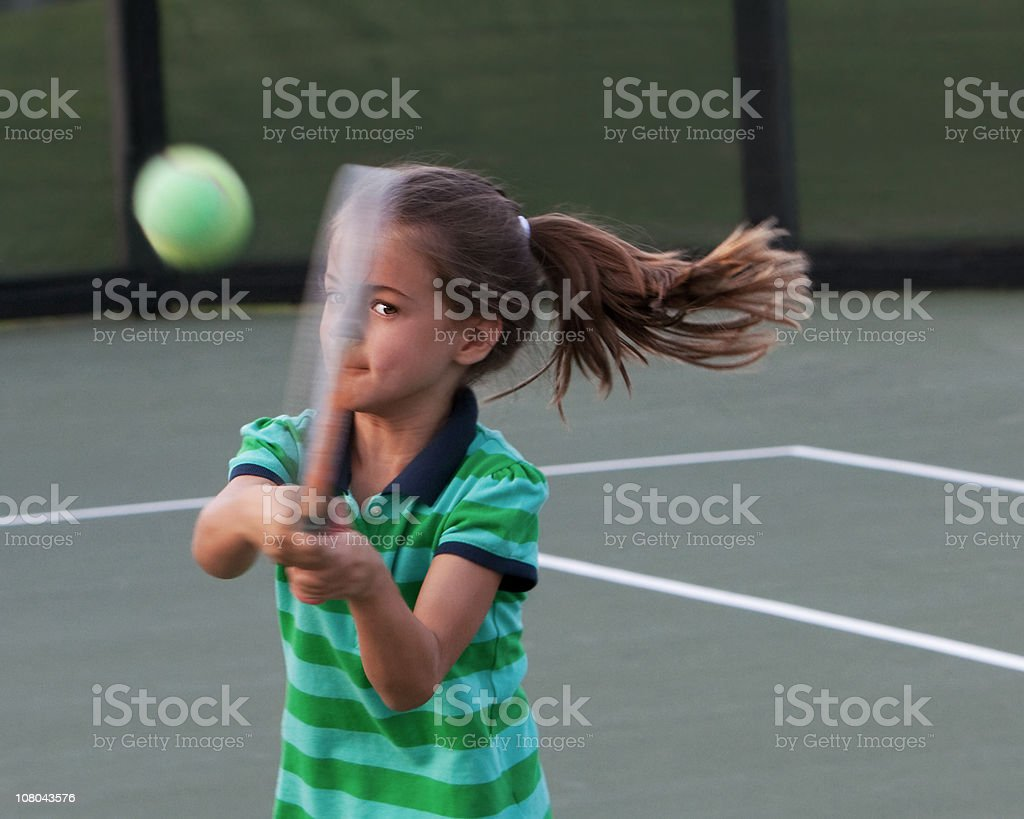Little Tennis Player with Eye on the Ball royalty-free stock photo