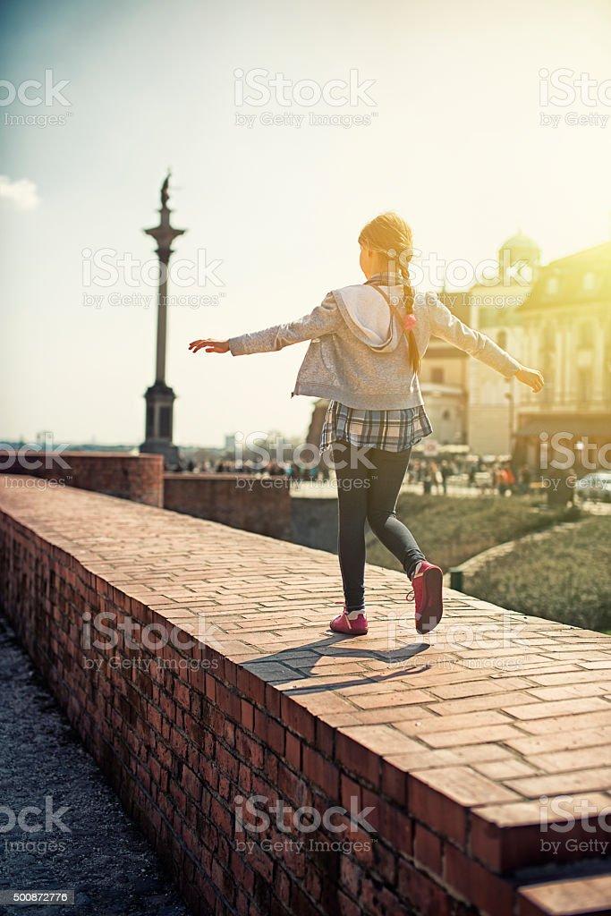 Little tourist girl visiting Warsaw stock photo