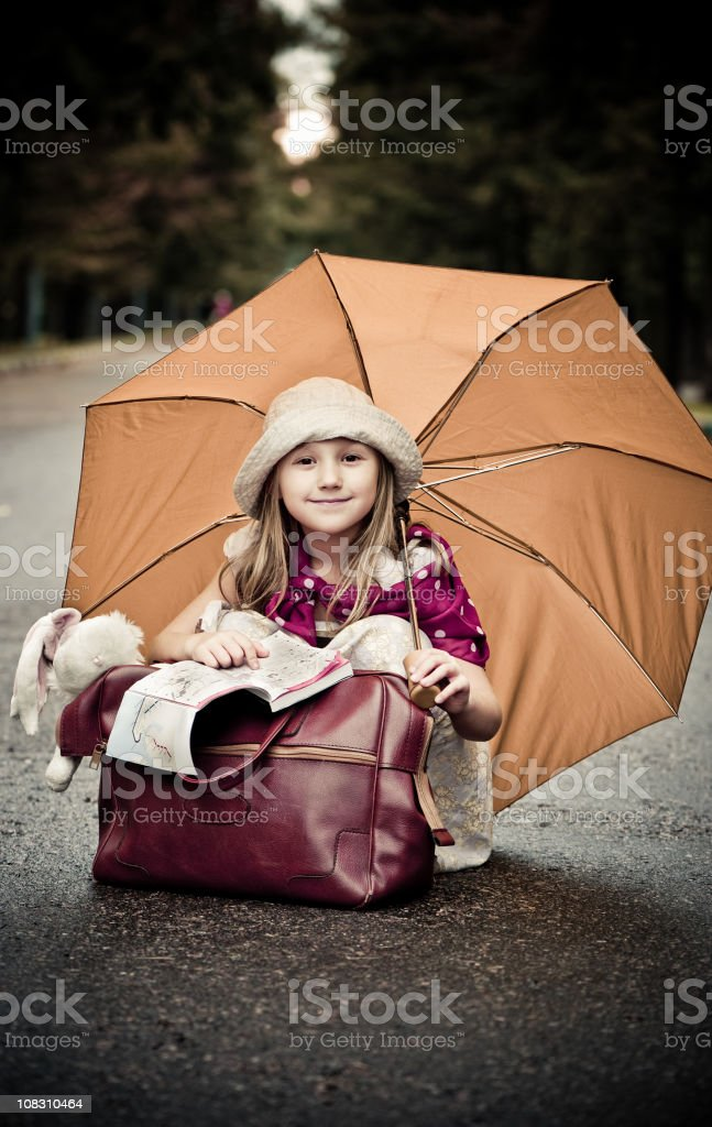 Little traveler in the city park stock photo