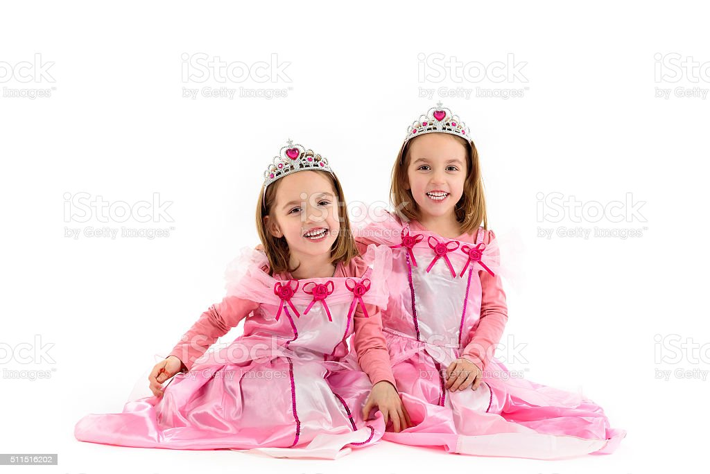 Little Twin Girls are dressed as princess in pink stock photo