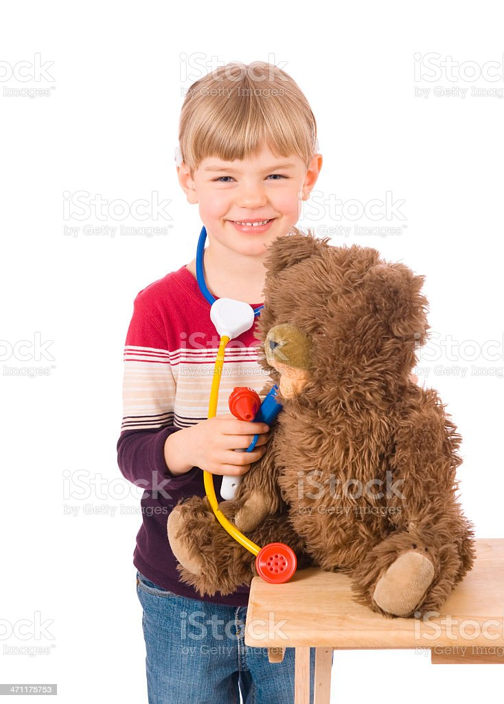 Little vet with a teddy bear royalty-free stock photo