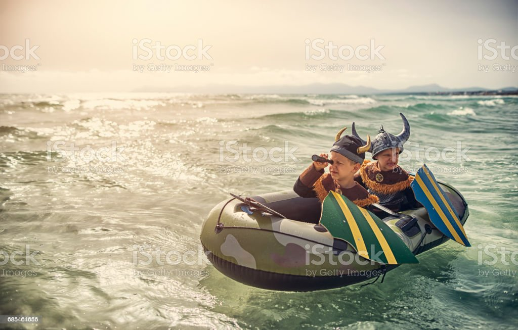 Little vikings on a boat looking for someone to raid stock photo