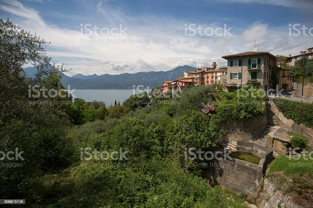 Little village on a mountainside at the gardasee in italy stock photo