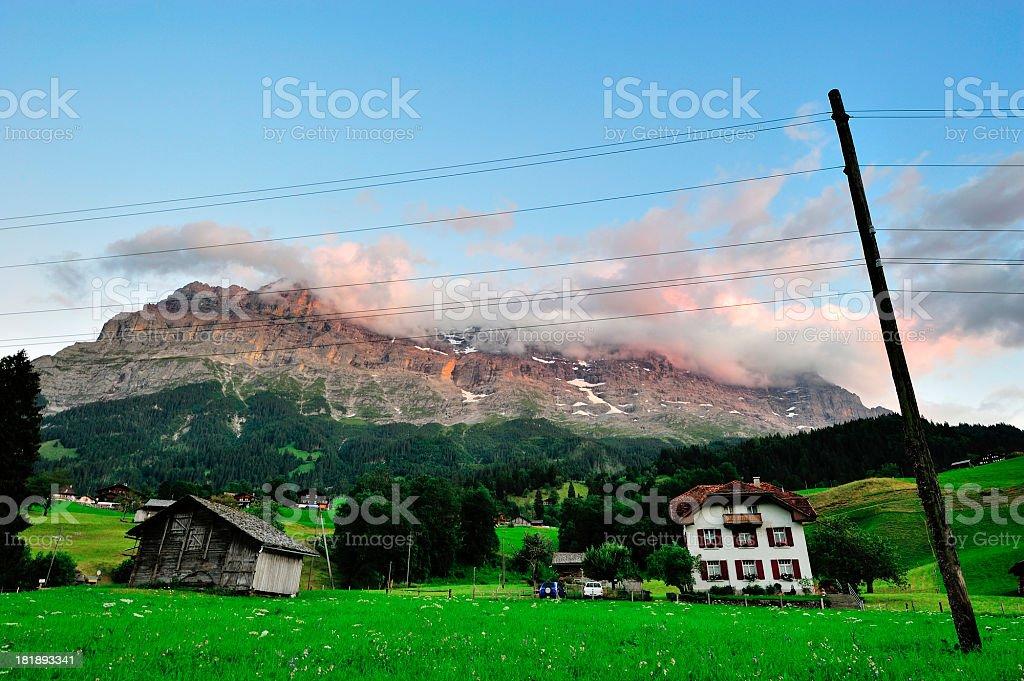 Little Village with Mountain in Twilight, Switzerland stock photo