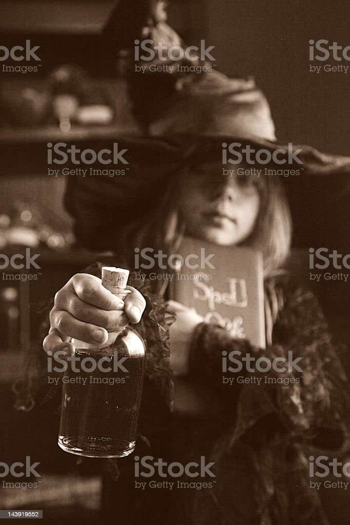 Little vintage witch stock photo