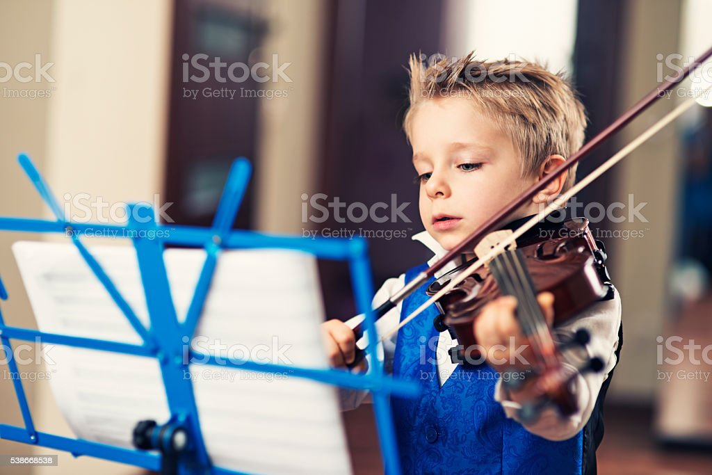 Little violin virtuoso stock photo