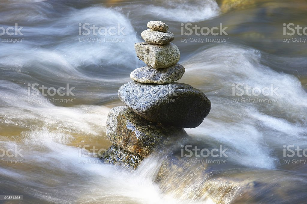 little watercourses with many stones stock photo